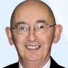 Frank O'Shea headshot, glasses, smiling