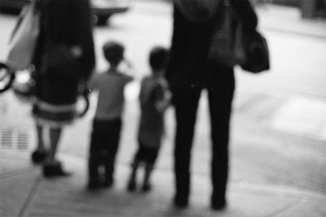 Blurry image of kids with parents