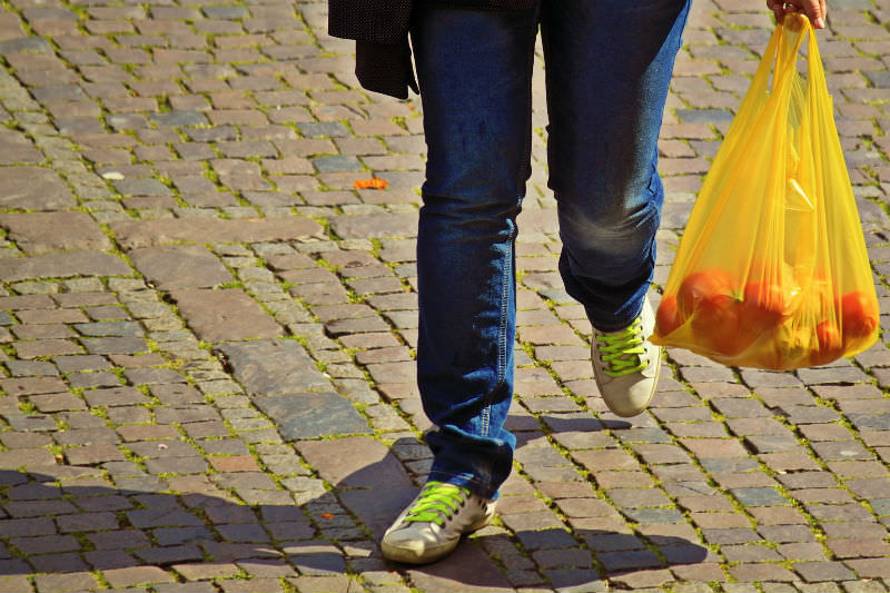 Shopper with plastic bag