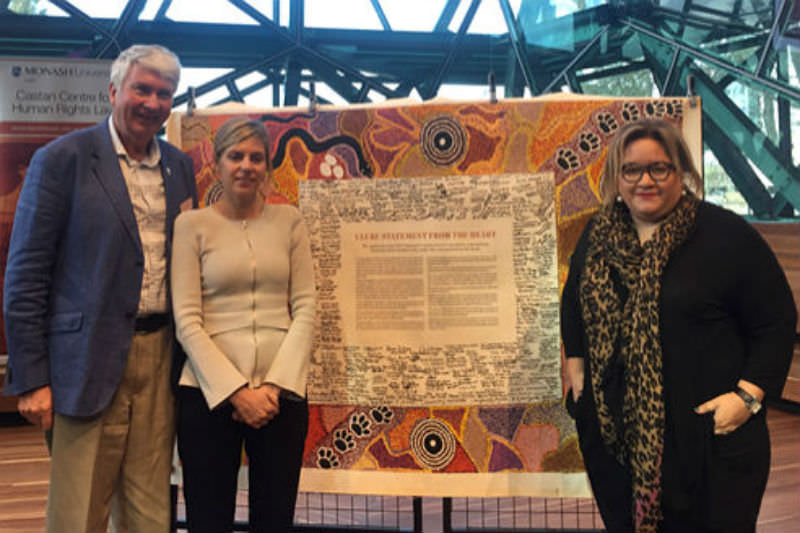 Frank Brennan, Kristen Hilton of VEOHRC and Professor Megan Davis of UNSW at the Castan Centre Human Rights Conference 2018 in front of the Uluru Statement from the Heart.