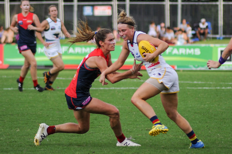 Cat Phillips attempting to tackle Dayna Cox during the AFL Women's round six match between Adelaide and Melbourne on 11 March 2017 at TIO Stadium in Darwin, Northern Territory (Flickerd/Wikimedia commons)