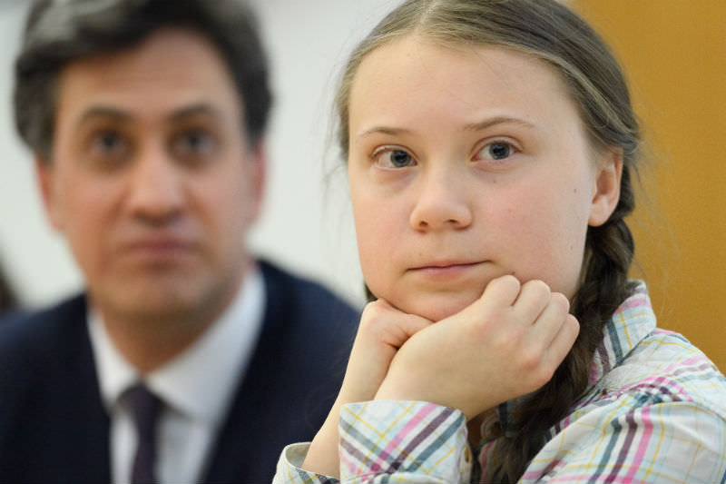 Former Climate Change Minister Ed Miliband looks on as Swedish environmental campaigner Greta Thunberg addresses politicians, media and guests with the Houses of Parliament on 23 April 2019 in London, England. (Photo by Leon Neal/Getty Images)
