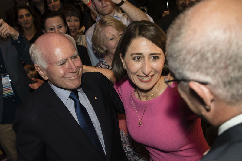 Gladys Berejiklian is greeted by former PM John Howard and current PM Scott Morrison on election night. (Brook Mitchell/Getty Images)