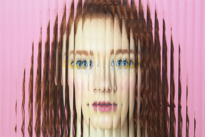 Woman's face obscured behind opaque glass (Tara Moore / Getty Creative)