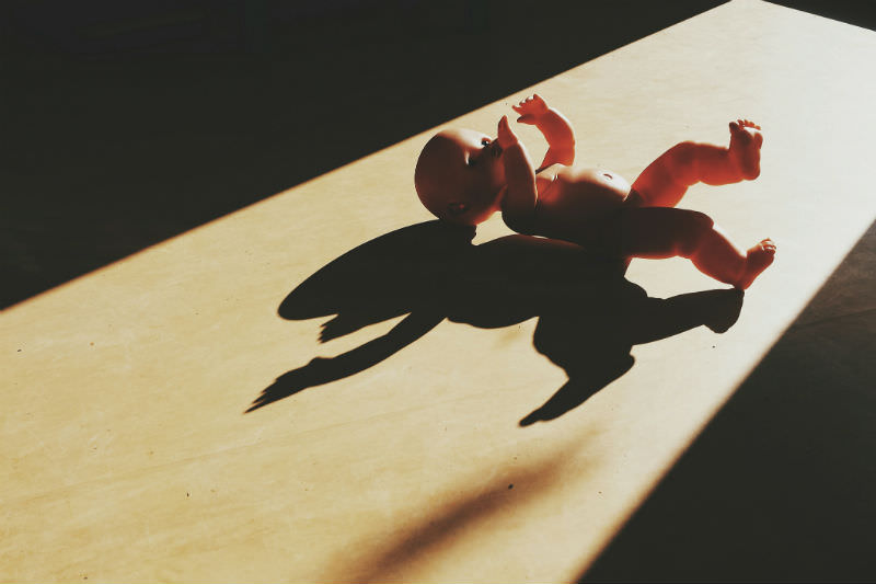 High angle view of doll on hardwood floor (Xavier Serrano / EyeEm / Getty Creative)