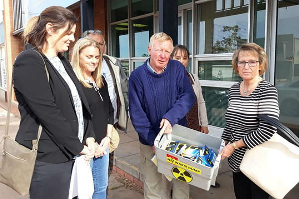 Pictured: Greg Bannon (centre), Chairperson of FLAG, with Kimba and Flinders Ranges community members, ready to present hundreds of postcard petitions to Rowan Ramsey, Coalition federal member for Grey. Photo credit: Mara Bonacci