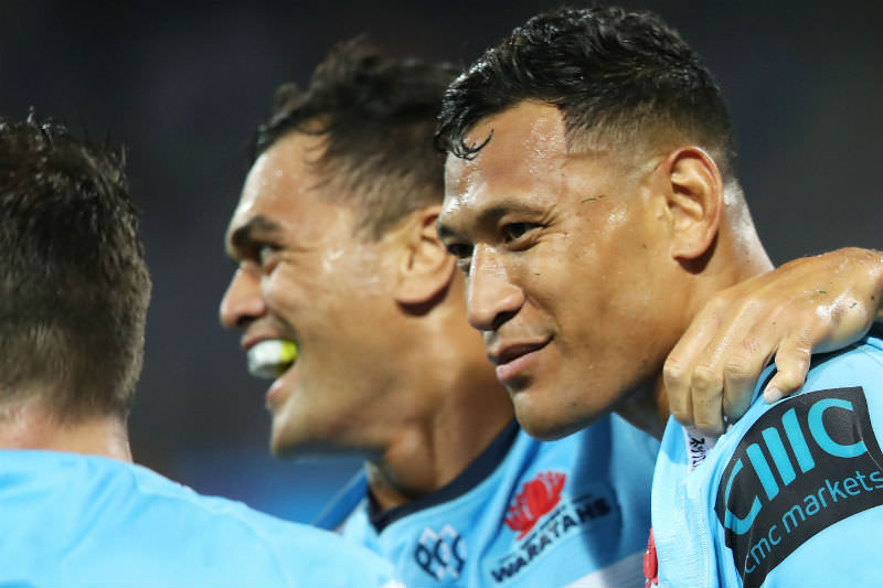 Israel Folau (right) and Karmichael Hunt celebrate Folau scoring a try during the round six Super Rugby match between the Waratahs and the Crusaders on 23 March 2019. (Photo by Mark Kolbe/Getty Images)