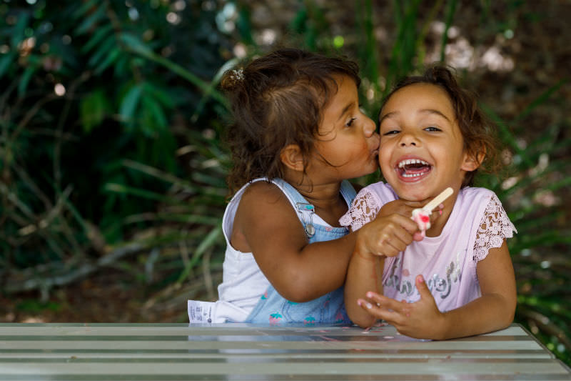 Two Young Australian Aboriginal girls eating an ice cream And laughing (Photo by Thurtell / Getty Creative)