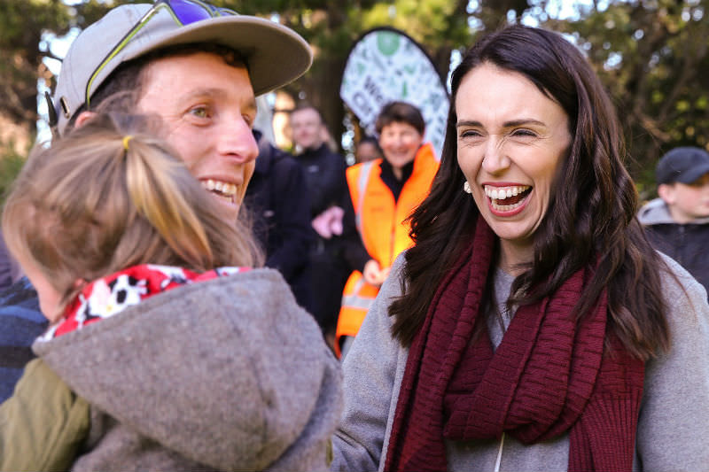 New Zealand Prime Minister Jacinda Ardern attends a tree planting event at Mount Victoria in Wellington in June 2019. (Photo by Hagen Hopkins/Getty Images)