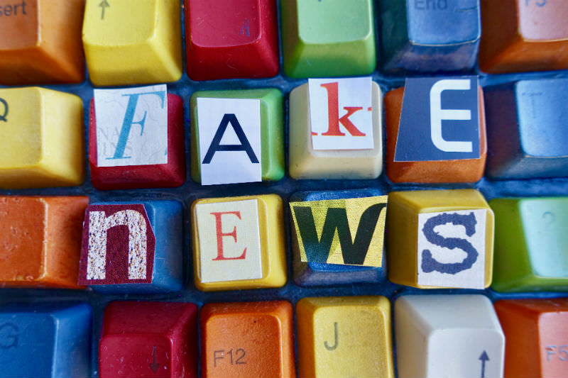 Letters cut out to spell 'fake news' and pasted onto the keys of a colourful keyboard. (Credit: clu via Getty)