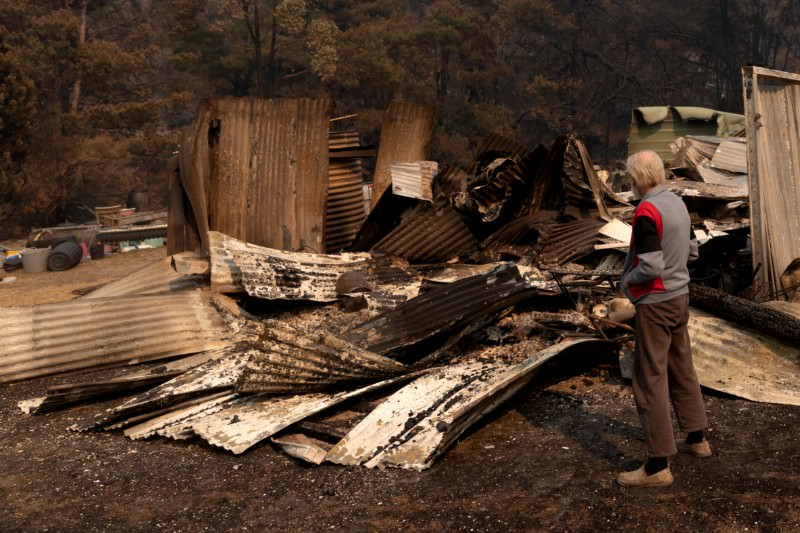 Andrew Mackenzie surveys the burnt out remains of a property in Torrington, Qld, on 11 November 2019. (Photo by Brook Mitchell/Getty Images)