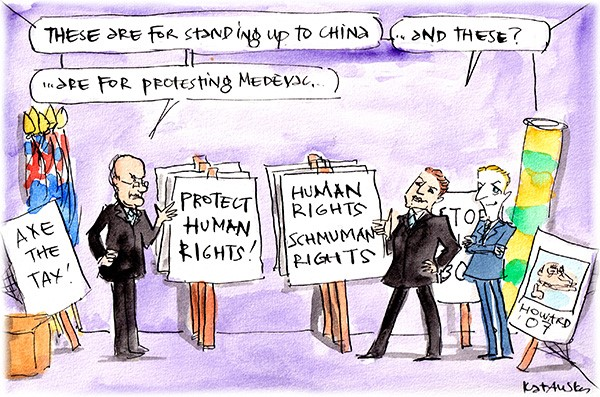 In this Fiona Katauskas cartoon, placards for defending China read 'Protect human rights' and those protesting Medevac say 'Human rights schmuman rights'