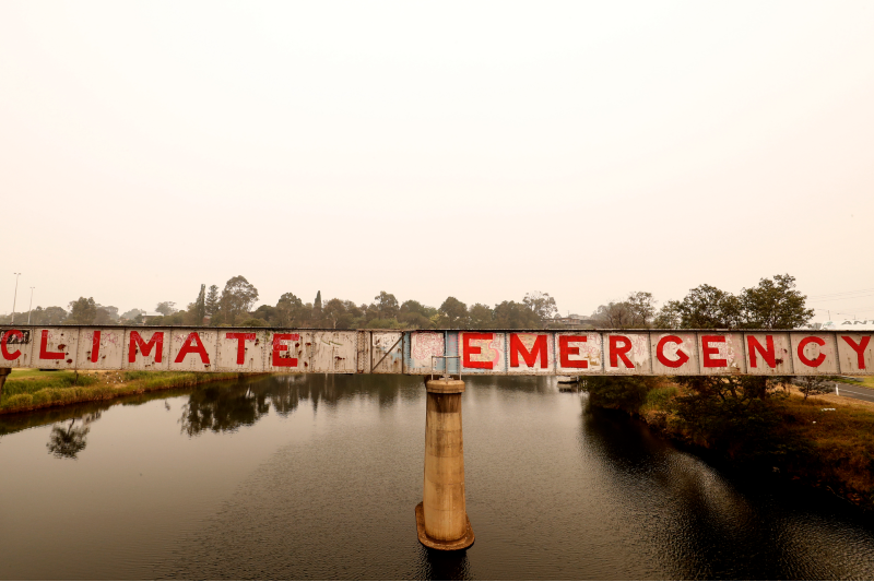 Graffiti reading 'climate emergency' is seen on a bridge on 3 January 2020 in Bairnsdale, Vic. (Photo by Darrian Traynor/Getty Images)