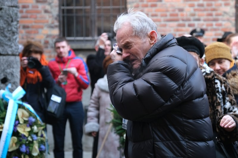 A member of a delegation of survivors of the Auschwitz concentration camp and their families breaks into tears at the execution wall at the former Auschwitz I site on 27 January 2020. International leaders and approximately 200 survivors and their families gathered at Auschwitz to commemorate the 75th anniversary of the camp's liberation. (Photo by Sean Gallup/Getty Images)