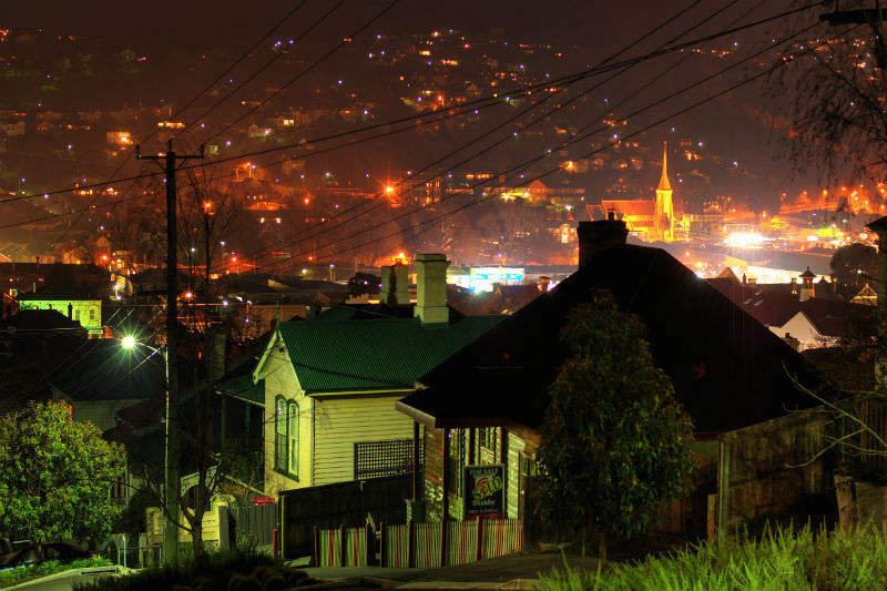 Night view of the city of Launceston, Tasmania, with houses in the foreground and the Sacred Heart Church in the background. (Getty images/Jess Swallow)