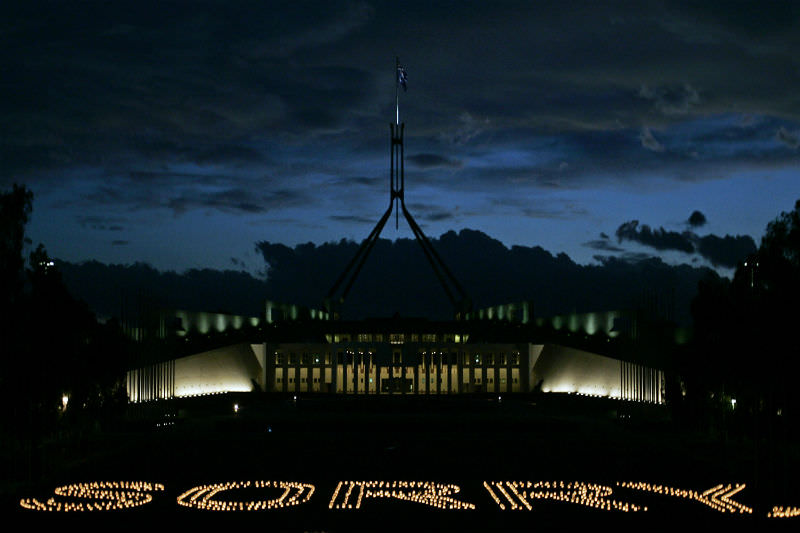 Candles spelling out sorry on the front lawn of Parliament House in Canberra (Getty images/Andrew Sheargold)