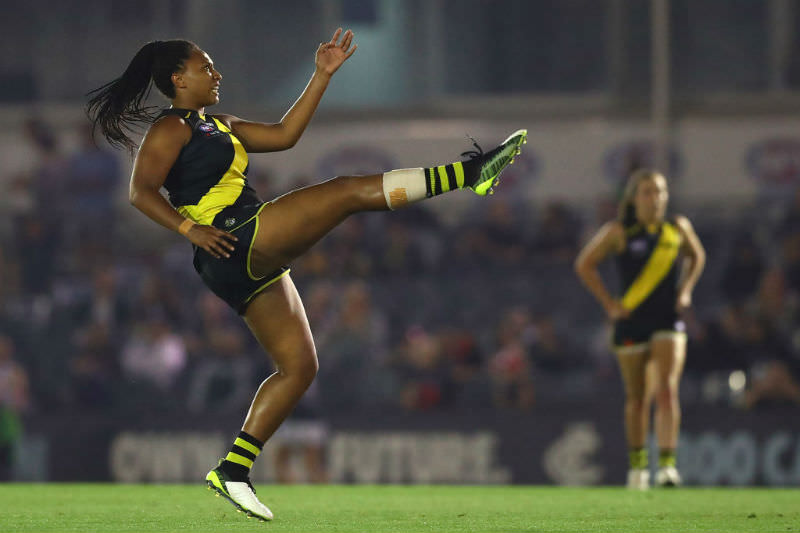 Sabrina Frederick of the Tigers kicks a goal during the round one AFLW match between the Richmond Tigers and the Carlton Blues at Ikon Park on February 07, 2020 in Melbourne, Australia. (Photo by Kelly Defina/Getty Images)