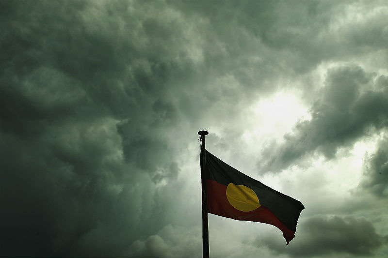 An Aboriginal flag waving against a stormy sky (Getty Images/ Sean Garnsworthy)