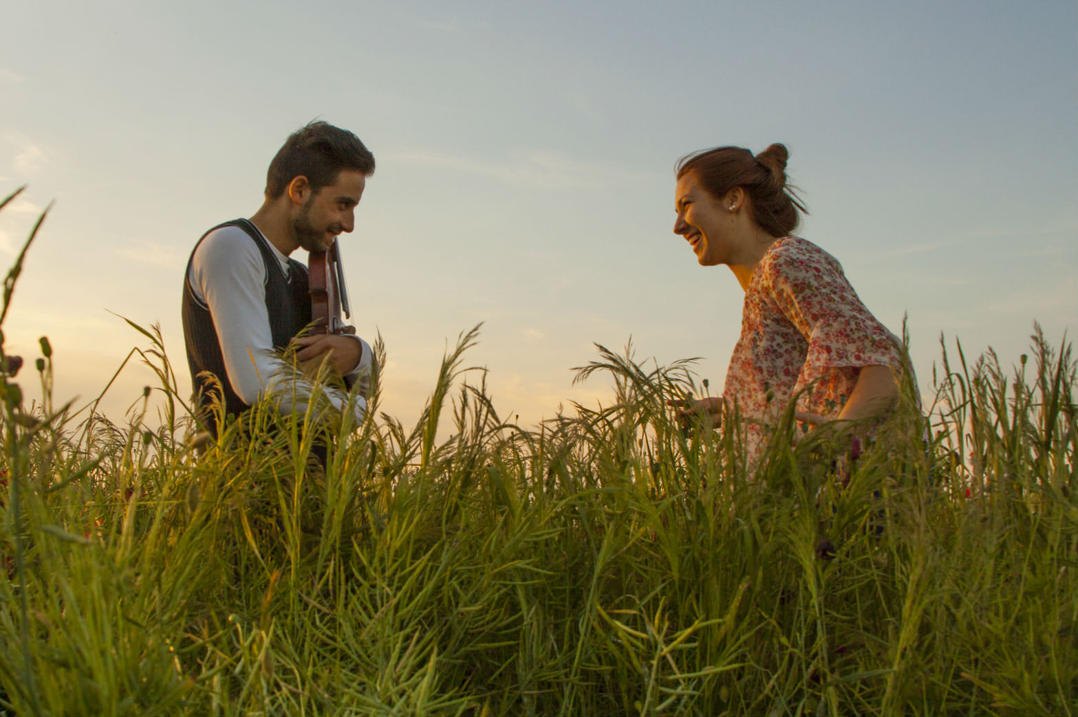 Two people talking in a meadow (Getty images/SandraKavas)