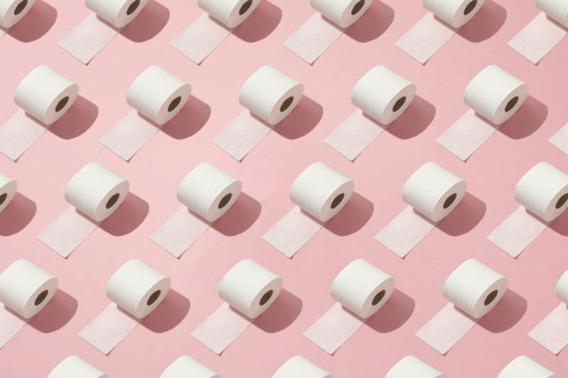 Toilet rolls on a pink background (Getty images)