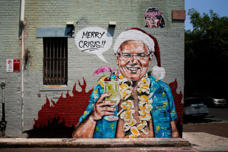 A mural by artist Scott Marsh depicting Prime Minister Scott Morrison on holiday in Hawaii is seen on December 26, 2019 (Getty images/Jenny Evans)