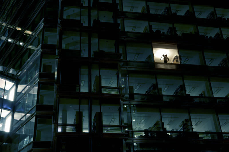 Man alone in an office building (Getty images/Nick Dolding)