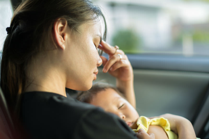Mother with her baby in a car (globalmoments/Getty Images)