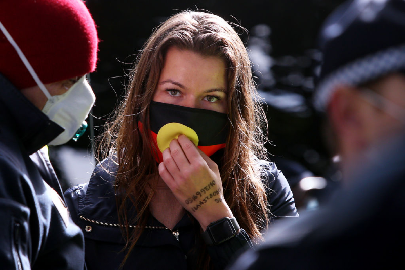 Protestor is arrested at Black Lives Matter protest in Sydney (Lisa Maree Williams/Getty Images)