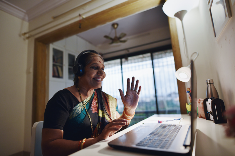 Grandmother on video call using laptop (Mayur Kakade/Getty Images)