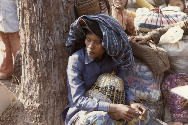 A Cambodian woman during evacuation following an attack on refugee camps along the Thai-Cambodian border. (Jesuit Refugee International)