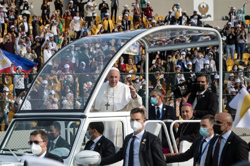 Main image: Pope Francis waves to the crowd as he arrives to conduct mass at the Franso Hariri Stadium on March 07, 2021 in Erbil, Iraq (Chris McGrath/Getty Images)