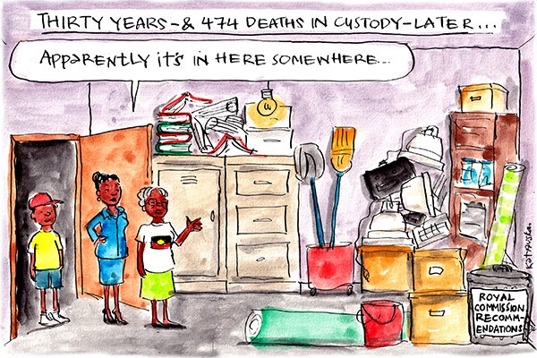 Title: Thirty years and 474 deaths in custody later... In a storage room three Aboriginal people stand. A woman says, 'Apparently it's in here somewhere.' Tucked behind boxes in a bin labelled, 'Royal Commission recommendations.'