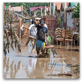 Image of man with chairs from Iligan City by Bobby Timonera, courtesy Caritas