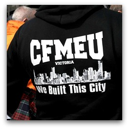 CFMEU logo on the back of a jacket worn by a man