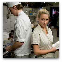 Chef and waitress in restaurant kitchen