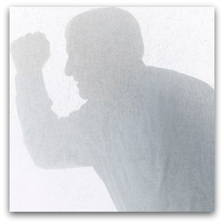Angry male silhouette with raised fist