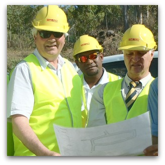 Fr Frank Brennan and Bob Katter with Mayor Alf Lacey and councillors of Palm Island inspecting new subdivision.