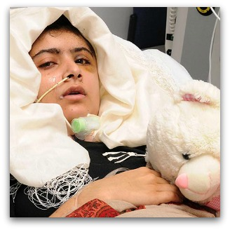 Malala Yousafzai in hospital bed with a teddy
