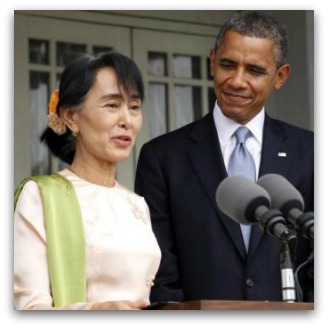 Aung San Suu Kyi and Barack Obama behind podium