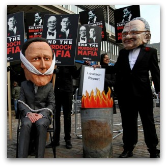 Protestors, one wearing a Rupert Murdoch mask and burning the Leveson report. Placards read 'End the Murdoch Mafia'