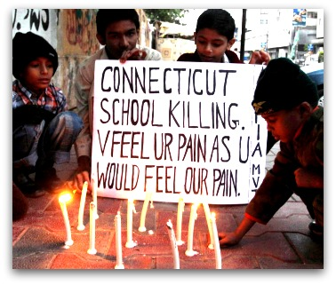 Pakistani children light candles to pay tribute to Sandy Hook Elementary School shooting victims in southern Pakistani port city of Karachi   Read more http://www.prafulla.net/graphics/photography/in-photos-the-world-grieving-for-sandy-hook/