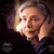 Emanuelle Riva in Amour, stares into space as her husband holds her face in his hands