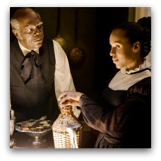 Samuel L. Jackson stares menacingly at Kerry Washington in Django Unchained