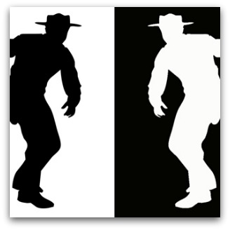 Silhouette drawing of black and white cowboys facing off