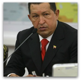 Hugo Chavez behind a microphone at the UN, listening
