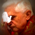 Pope Benedict wipes eyes with a tissue