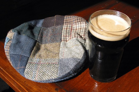 Old Irish cap and glass of Guinness