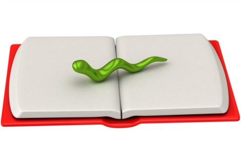 Green bookworm on open blank book