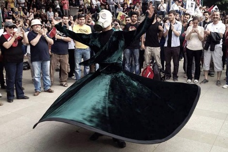 A whirling sufi wearing gas mask during the protests in Turkey in Gezi Park