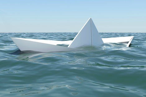 Paper boat sinking